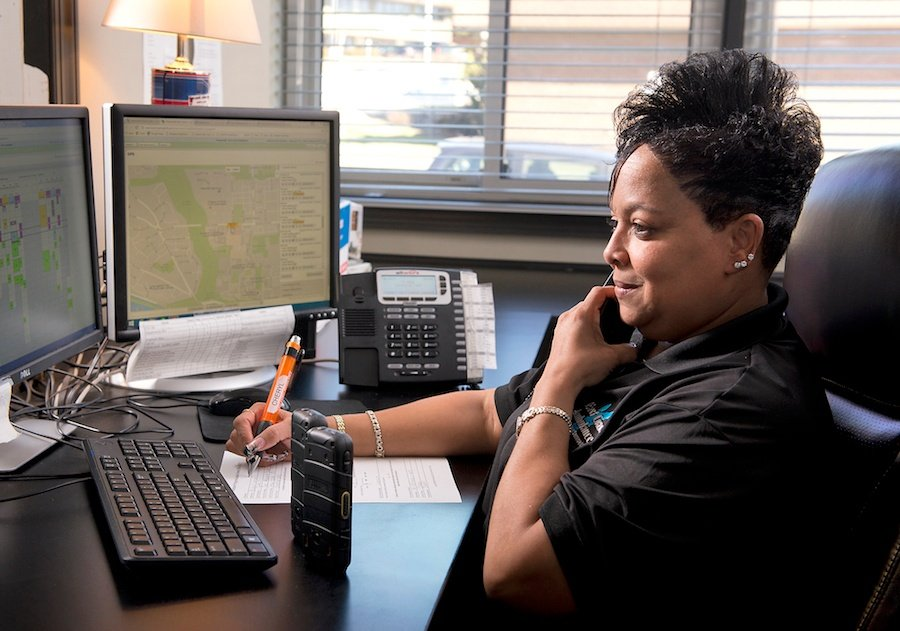 cheryl in the dispatch office with large pen   east coast ambulance.jpg